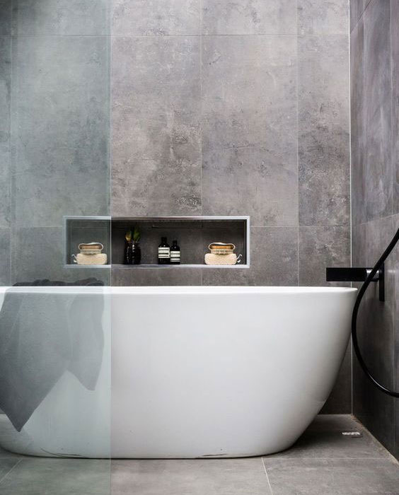 Natural stone tiles & large bath - Munday Taylor Lamont